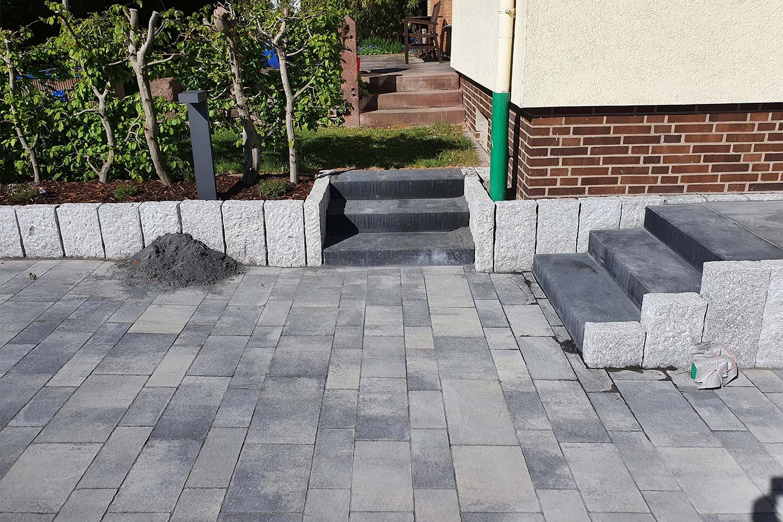 Erneuerung der Grundstückszufahrt und der Eingangstreppe